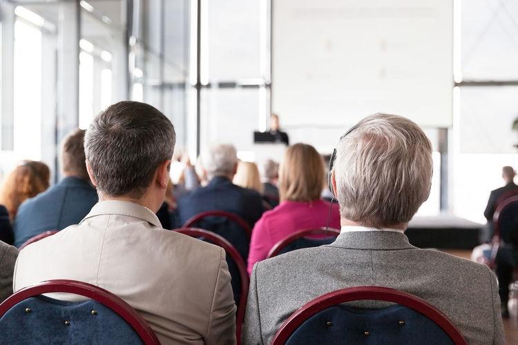 Rear View Of People In Seminar