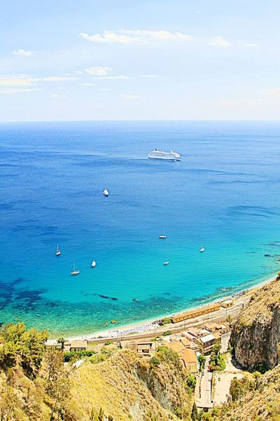Taormina And Etna Sea Beach Nautical Vessel Blue Water Horizon Over Water Scenics Outdoors Sky Transportation Nature Coastline Beauty In Nature No People Day