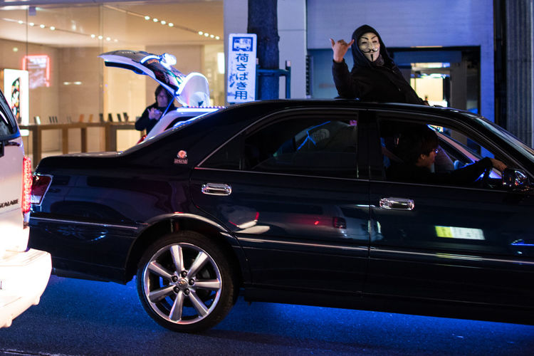Car Motor Vehicle Mode Of Transportation Transportation Land Vehicle Real People People City Night Security Luxury Government Anonymous Anonymous Mask Costume Shibuya Capture Tomorrow Streetwise Photography
