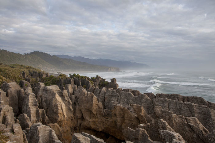 Beauty In Nature Breathtaking Cloudy Geology Landscape Mountain Newzealand Pancake Rocks Physical Geography Rock - Object Rock Formation Rocky Seaside Shore Sky Stunning View The Great Outdoors - 2016 EyeEm Awards Tranquil Scene Water Feel The Journey Finding New Frontiers Miles Away Perspectives On Nature