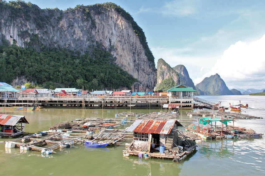 Koh Panyi (Koh Panyee) is a touristic village or Floating Sea Gypsy Village in Phang Nga Province, Thailand, near James Bond Island. Notable for being built on stilts by Indonesian fisherman. Floating Village Gigantic Limestone Rock Gypsy Island Island Life Jungle-covered Island Ko Panyi Koh Panyee Koh Panyi Landscape Landscape_Collection Limestone Walls Mode Of Transport Over Water Panyee Island Phangnga Phuket Thailand Thailand_allshots Tourist Destination Travel Destinations Travel Photography Traveling Village Life Village View