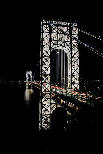GWB George Washington Bridge IllumniiGanG New York New York City Traffic Travel Traveling Arch Architecture Bridge - Man Made Structure Building Exterior Built Structure Connection Light Trail Night No People Outdoors Sky Suspension Bridge Traffic Lights Water