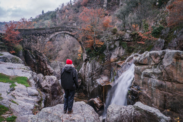 National Park Peneda Geres An Eye For Travel Business Stories Castle EyeEmNewHere FUJIFILM X-T2 Kornspeicher Lindoso Misarela Bridge National Park Nature Peneda-Gerês National Park Ponte De Misarela Portugal Shades Of Winter Adult Adventure Backpack Beauty In Nature Bridge Cliff Climbing Day Espigueiros Espigueiros Do Lindoso Explore Fujifilm Full Length Motion Mountain Nature One Person Outdoors People Real People Rock - Object Rock Climbing Scenics Sky Tourism Travel Destinations Tree Water Waterfall