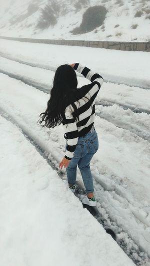 Full length of boy standing on snow