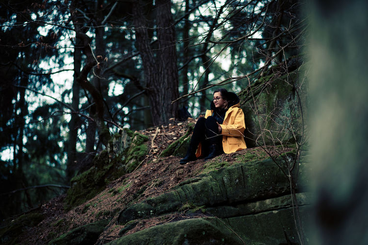 Woman Sitting In A Forest