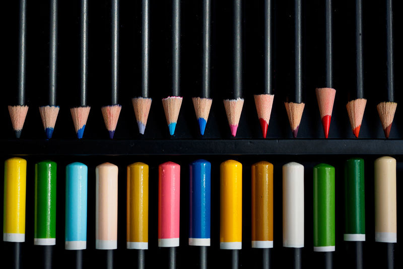 Directly Above Shot Of Colored Pencils Arranged In Box