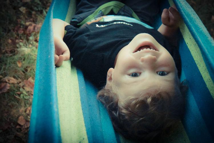 Portrait of cute boy lying down