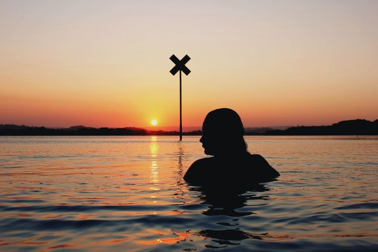 Sunset soak. Sunset Reflection Water Adult Lake One Person People Tranquility Outdoors Nature Young Adult Day Sky Model Silhouette Beauty Beautiful Girl Water Reflections Colors Sign