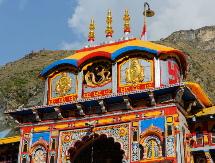 Badrinath Temple Badrinath Hinduism Mandir Architecture Belief Building Building Exterior Built Structure Day Hindu Temple Low Angle View Mountain Multi Colored Nature No People Ornate Outdoors Place Of Worship Religion Sky Spirituality Tourism Travel Travel Destinations Uttarakhand