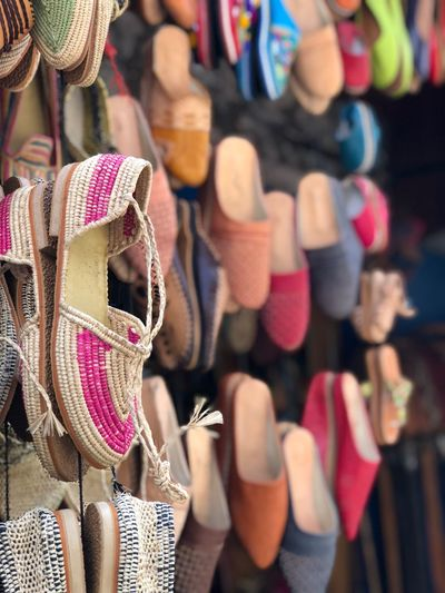 Colorful shoes hanging for sale at market