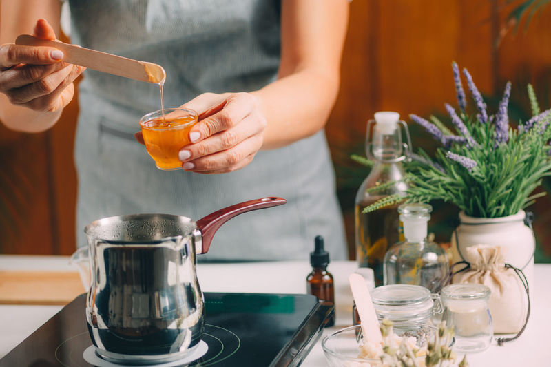 Woman making homemade soap with honey