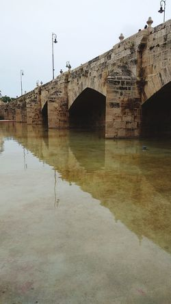 Stone Bridge in Valencia, Spain Stone Bridge Old Bridge Stone Material Flood Sky Arch Bridge Historic Standing Water Arch Calm Archway Bridge