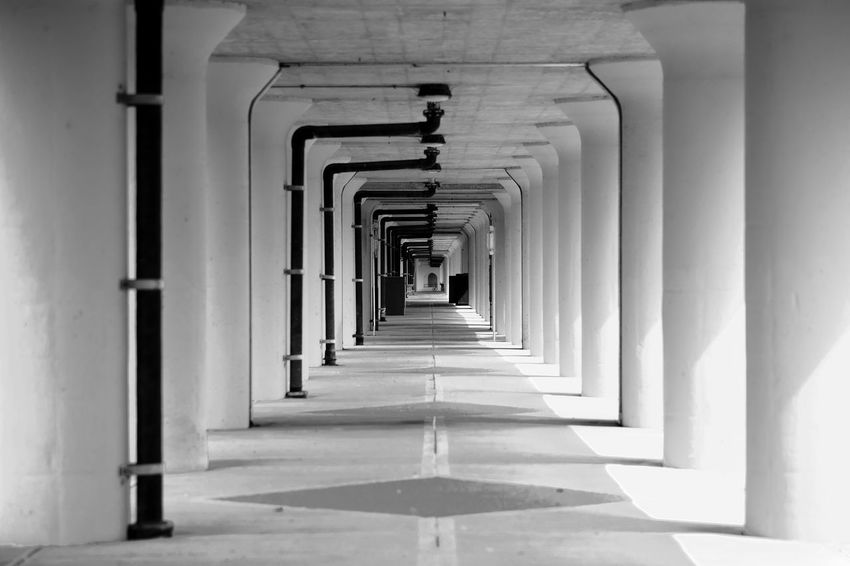 Long Way Forward Arch Architectural Column Architecture Bicycle Built Structure Corridor Day Diminishing Perspective In A Row Indoors  No People The Way Forward
