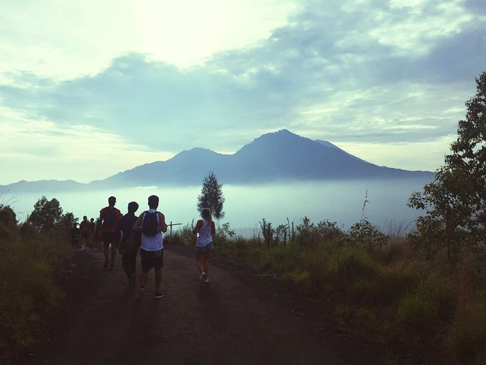 Sunrise at mount batur (mount agung on the horizon) Mountain Sky Nature Real People Lifestyles Leisure Activity Women Scenics Outdoors Landscape Men Beauty In Nature Day Togetherness People