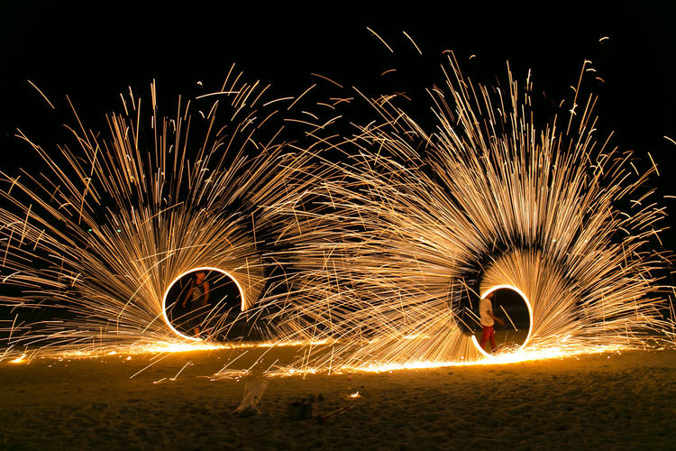 Motion Wire Wool Illuminated Night Long Exposure Blurred Motion Glowing Sparks Spinning Burning Warning Sign Sign Real People Fire Fire - Natural Phenomenon Nature One Person Speed Lifestyles Land Outdoors Skill  Light