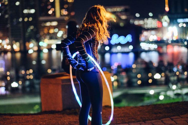 Celebration City Depth Of Field Fun Happiness Hula Hooping  Hulahoop Illuminated Lifestyles Night Real People Women