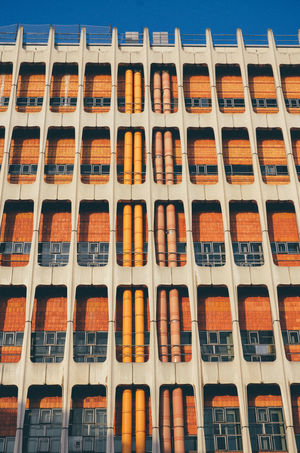 Abundance Architecture Arrangement Backgrounds Building Building Exterior Built Structure Close-up Day Full Frame In A Row Industry Large Group Of Objects No People Old Orange Color Outdoors Pipe Pipe - Tube Shelf Sky Vintage Windows
