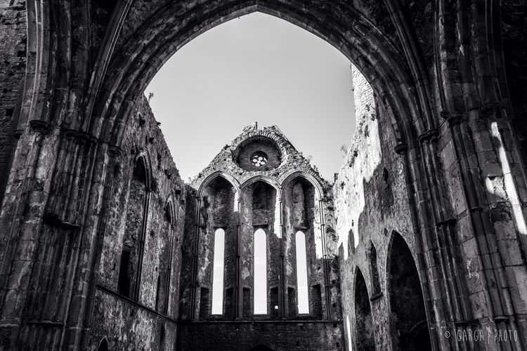 The ancient and majestic Rock of Cashel Heritage Ireland Abbey Blackandwhite Built Structure Architecture History Low Angle View Place Of Worship Religion Day Arch Travel Destinations No People Building Exterior Sky