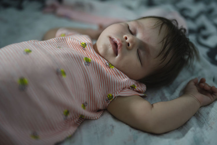 Cute baby lying on bed