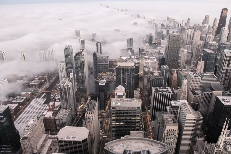 A foggy Chicago morning Cityscape Building Exterior City Skyscraper Architecture Built Structure High Angle View Building Sky Urban Skyline Day Tall - High Landscape Aerial View Travel Destinations Outdoors Modern Financial District  Chicago Architecture Architectural Feature Urban City Cityscape Weather