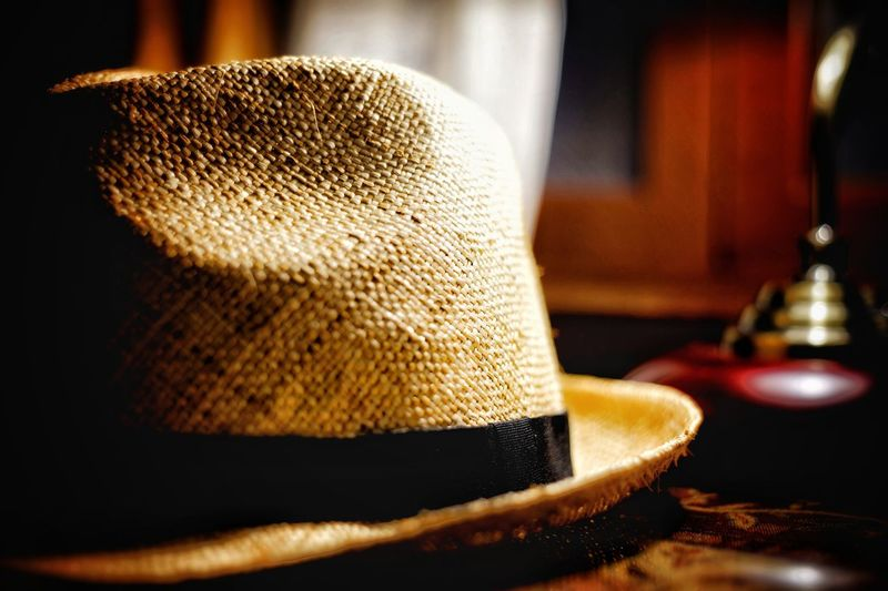 Close-up of hat on table