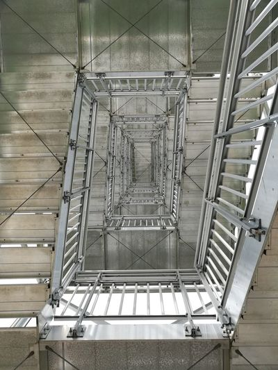 Metal Steps And Staircases No People Built Structure Architecture Geometric Staircase Railing Indoors  Low Angle View Industry Day Technology