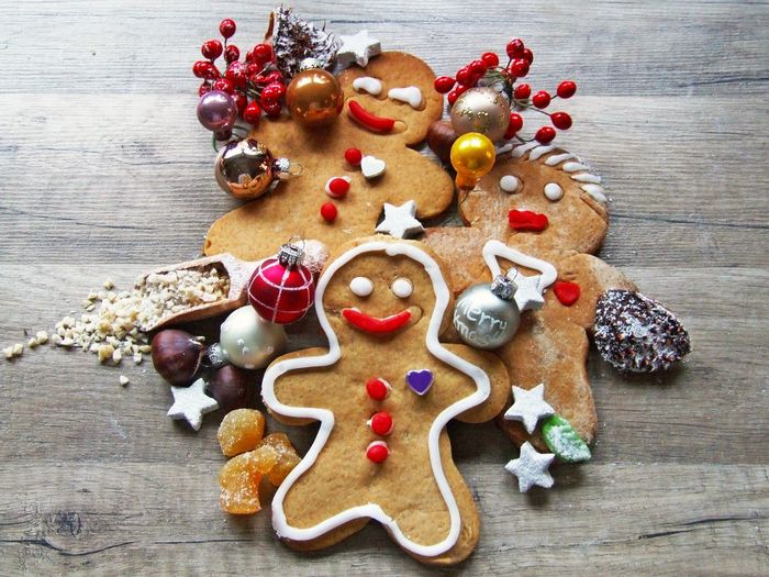 High Angle View Of Christmas Cookies And Decorations On Table