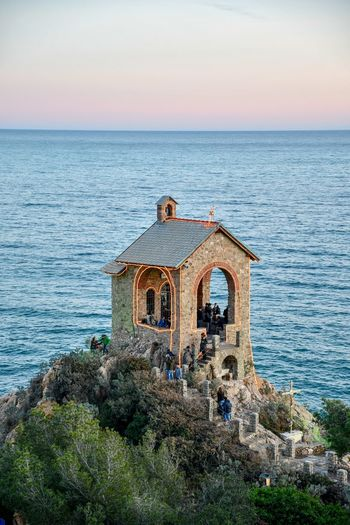 little chapel on the sea Liguria,Italy Seascape Sea Sunset Sea Sea Sunset Little Chapel People People And Places People At Sunset Beauty In Nature Travel Destinations Travel Tourists Tourism Tourist Attraction  Wintertime Rocks And Sea