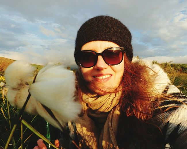 EyeEm Selects Sunglasses Young Women Roadtrip Adventure Front View Looking At Camera Worldtraveler Iceland Close-up New On Eyeem One Person Adult Self Potrait Smiling Cloud - Sky Day Portrait Outdoors Vacations Hat Wanderlust Summer Relaxation Sky