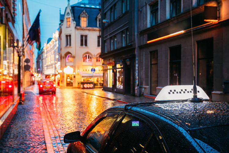 Taxi Car Wait Clients Near Cafe In Old European Streets In Rainy Evening. Night Street Illuminations. Colour Your Horizn Taxi Travel Wait Architecture Auto Cafe Car City Cobblestone Copyspace Europe Evening Illuminated Latina Night Outdoors Rainy Riga Road Street Transportation