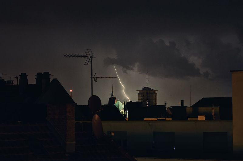 Cityscape Against Sky During Lightning At Night