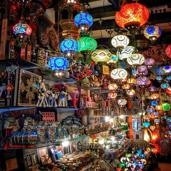 Shiny trinkets in Moroccan shops in Granada.