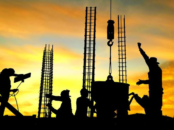 Silhouette construction workers are casting concrete in construction site with blurred sundown sky background in occupation concept Blur Background Twilight Sundown Clouds Evening Shadow People Workers Team Group Construction Site Technology Mason Occupation Structure Working Reinforcement Housing Outdoor Colorful Equipments Sunset Silhouette Togetherness Occupation Dusk Sky Architecture Focus On Shadow