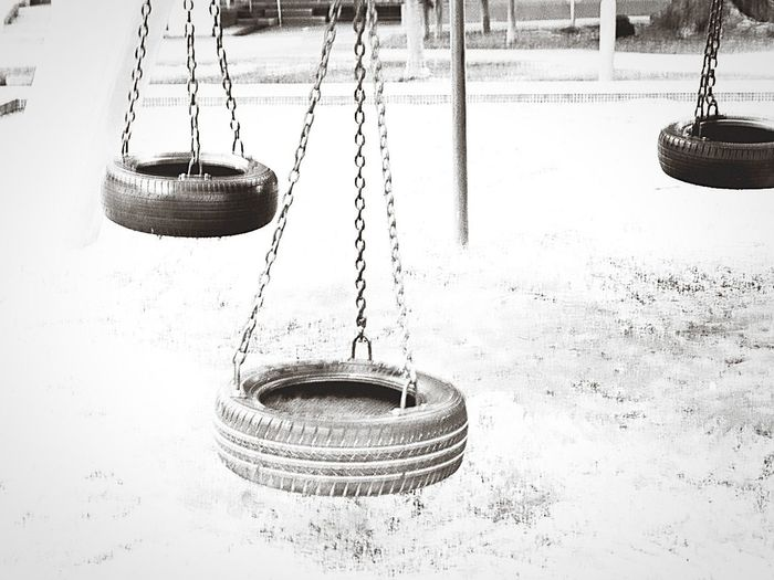 swinging in the breeze EyeEm Selects Swing Hanging Playground Outdoor Play Equipment Outdoors Day Urban Vintage Bw Mono
