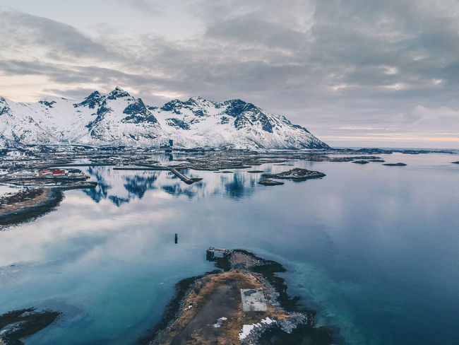 Norway Beauty In Nature Blue Cloud - Sky Cold Temperature Dronephotography Floating On Water Frozen Glacier Ice Lofoten Nature No People Outdoors Reflection Scenics - Nature Sea Sky Snow Snowcapped Mountain Tranquil Scene Tranquility Water Winter