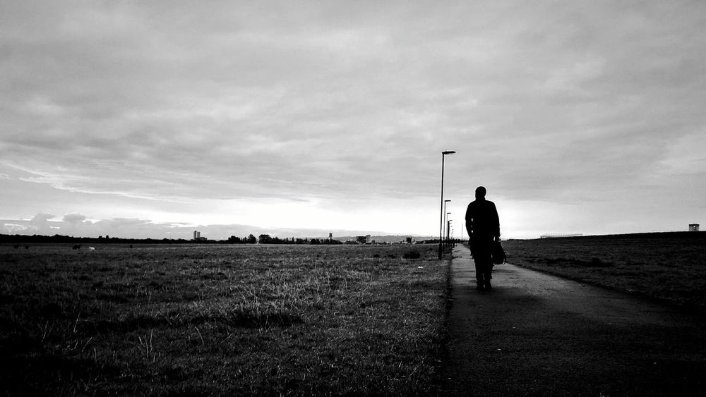 Only Men Sky Men Adult Silhouette Person Cloud - Sky One Person Standing Outdoors One Man Only Young Adult Day Community Outreach People Peoplephotography Commuterlife Commute Scenery Today. Black & White Capture The Moment Fine Art Photography Fashion High Street Fashion Snap A Stranger
