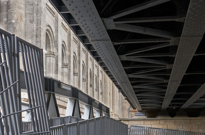 View from under urban train tracks very close to historic architecture