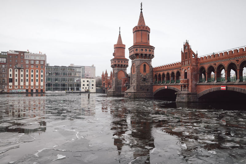 oberbaumbridge over spree river in Berlin city Berlin Berlin City Berlin Friedrichshain Cityscape Ice On The Water Oberbaumbrücke Sights & Views  Sightseeing Sightseeing Spot Winter Arch Architecture Berlin Kreuzberg Berlinstagram Bridge - Man Made Structure Building Exterior Built Structure City Day Germany History No People Oberbaumbridge Outdoors Sky Tourism Travel Travel Destinations Urban Icon Water