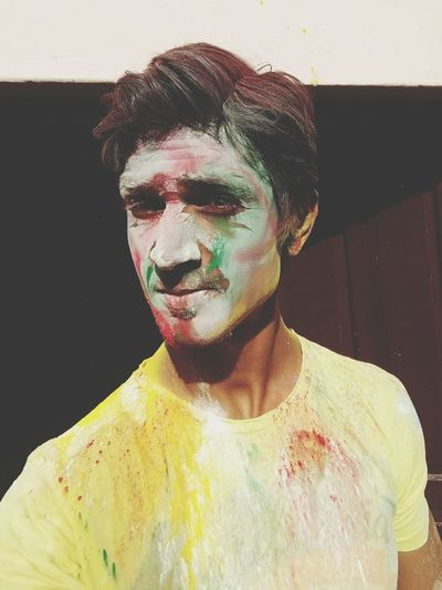 Close-up portrait of man covered with powder paint