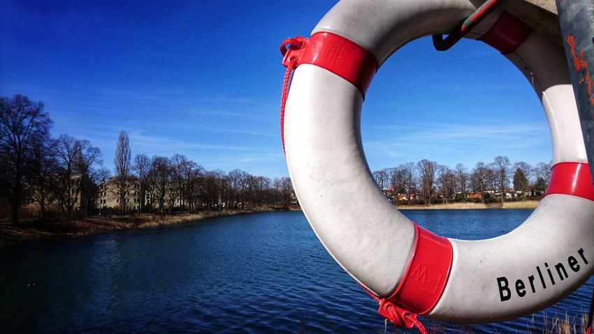 Walking along little lakes in Berlin 😉 Blue Sky Spring Walking Around City Life Cityscape Calmness Calm Berliner Berlin Photography Lake View Lakeside Spring Is Coming  Water Red Life Belt River Blue Sky Close-up Lifeguard  Nautical Vessel Inflatable Ring