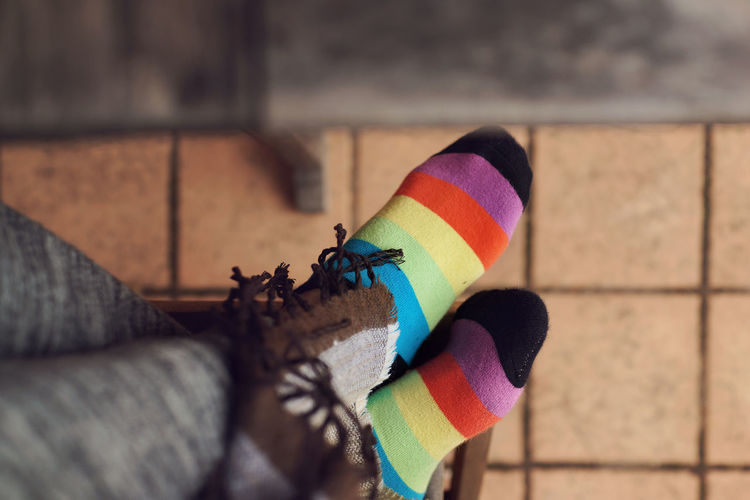 Girl wearing colouring striped socks Autumn Leg Relaxing Brown Cold Days Feet Female Floor Lifestyles Multi Colored Outdoors Pattern Socks Striped Urban Vintage