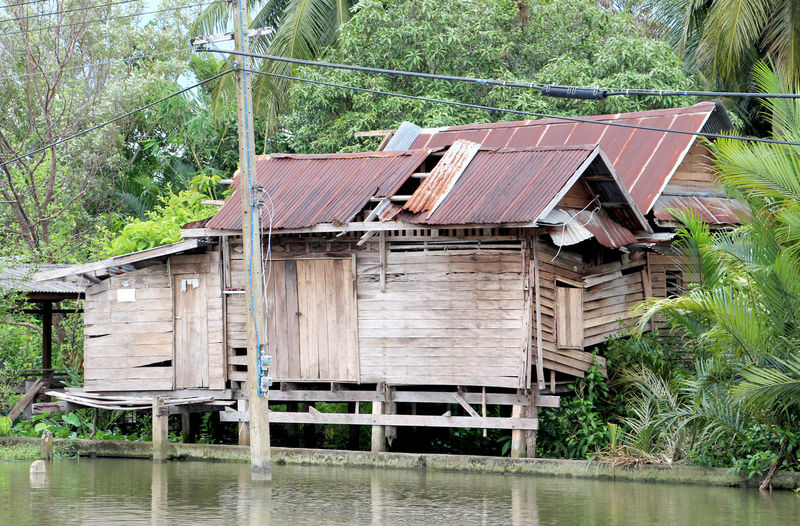 Built Structure Architecture Day Outdoors Water No People Stilt House Wood - Material Building Exterior Tree Nature Home Wooden Home Wood Old Fisherman Fishery  Riverside River Zinc Rust Electric Pole Relax Holiday Happy