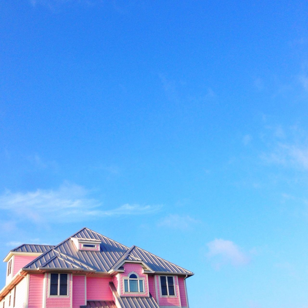 Pink house against blue sky