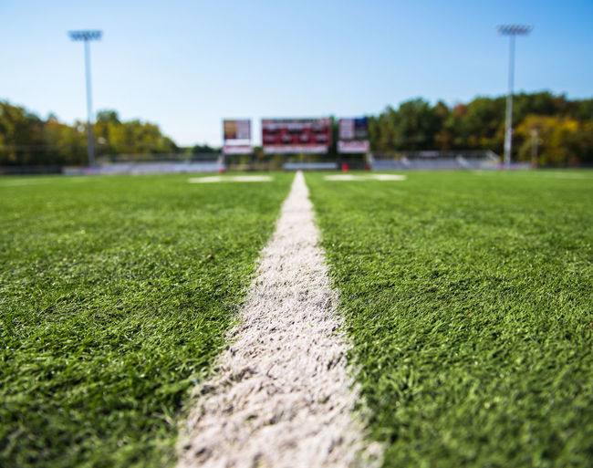 Adkins Stadium American Football Field Building Exterior Clear Sky Close-up Competition Competitive Sport Day Grass Green Color No People Outdoors Playing Field Selective Focus Sky Soccer Soccer Field Sport Team Sport Track And Field Stadium Tree