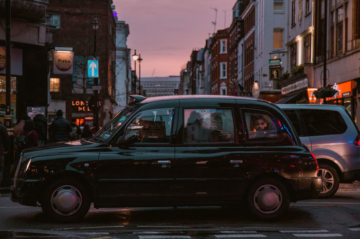 cruising down Soho streets Moody Light Lights Street Photography Street One Man Only City Life City City Lights Neon Dusk Evening Dusk In The City One Person Transportation People In Transit Transit Car Road London Sunset Shades Of Winter An Eye For Travel The Week On EyeEm Editor's Picks Mobility In Mega Cities Colour Your Horizn Adventures In The City The Street Photographer - 2018 EyeEm Awards HUAWEI Photo Award: After Dark