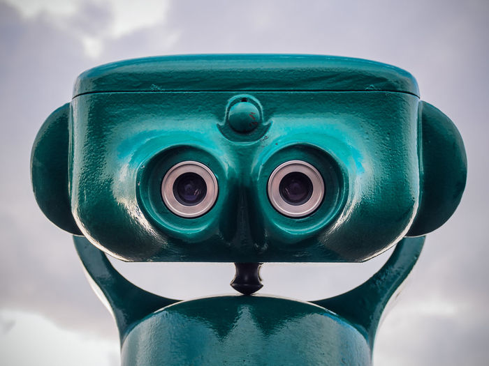 Binoculars like a face. Close-up Coin-operated Binoculars Day Green Color Metal No People Outdoors Outlook Rostock Sky Sky And Clouds Spyglas Telescope View Warnemünde Fresh On Market 2016