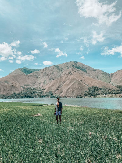 Palipi samosir, indonesia - a man stand in the rice field with lake and hills