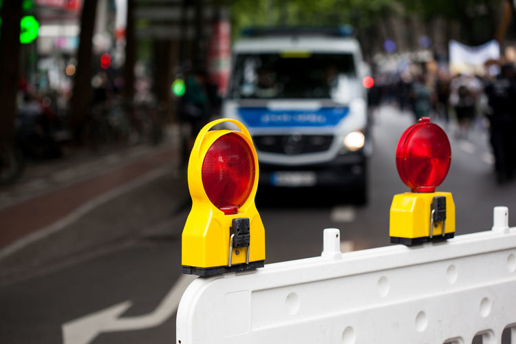 Close-up of road reflectors on street in city