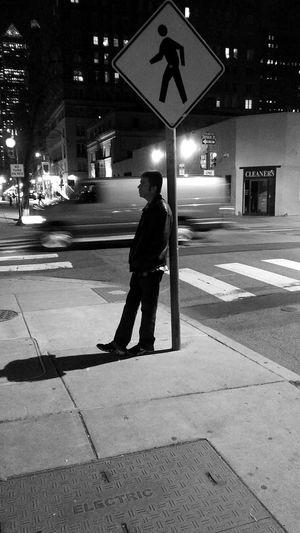 Full length of man walking in illuminated city