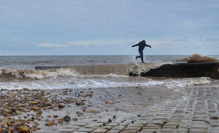 Too slow! Sea Wall Sea Waves Bank Holiday Filey Sea Water Beach One Person Land Real People Sky Cloud - Sky Outdoors Lifestyles